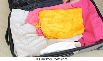 Folding clothes in travel bag