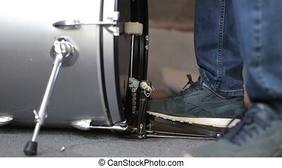 Closeup of drummer's foot moving drum bass pedal