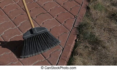 Country girl cleans the yard. - Country girl cleans the yard