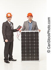 men standing with solar battery