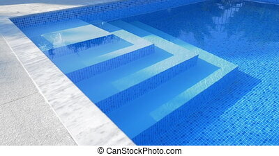 Stairs in outdoor swimming pool