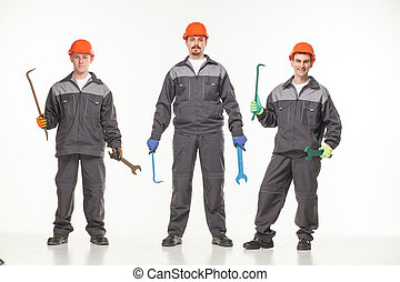 Group of industrial workers. Isolated over white background