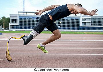 explosive start of athlete with handicap - Man handicap...