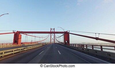 Driving on a 25 de Abril Bridge