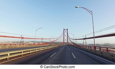 Driving on a 25 de Abril Bridge in Lisbon, POV from car