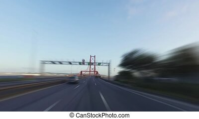 Blurred Driving on a 25 de Abril Bridge in Lisbon, sunny...