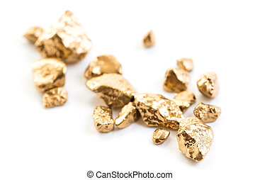 handful of gold nuggets close-up on a white background