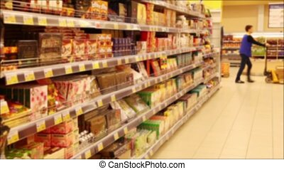 Shelves With Goods In The Superma - Shelves with goods in a...