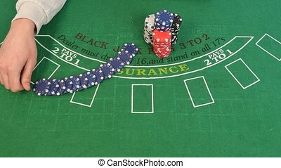 Man Apportions Poker Chips