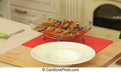 Chef is serving freshly baked ratatouille on a plate HD
