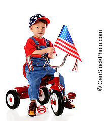 Patriotic Triker - A two-year-old waving an American flag...