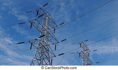 Power Line Towers On Blue Sky - Large towers with cables...