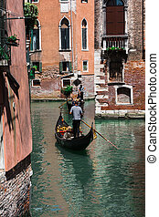 Gondolier in Typical Canal in Venice, Italy - Riding Gondola...