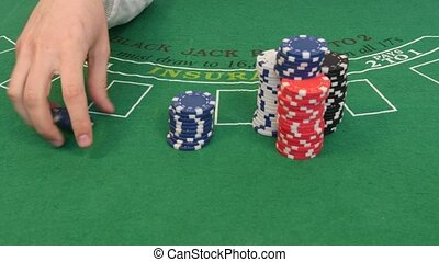 Man Playing with Poker Chip in 4k