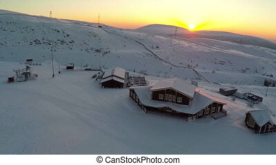 Aerial view of ski resort at sunset - Flying over the area...