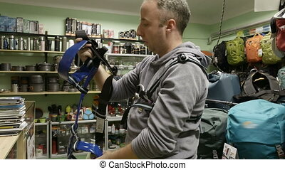 Man buys outfit alpinist climber mountaineer tools - Man...