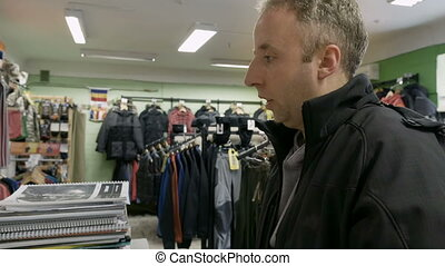 Man emotionally speaks to cashier or sales manager - Man...