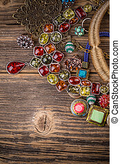 Necklaces made of rhinestones on wooden surface
