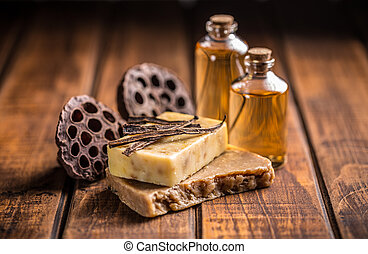 Handmade soap with vanilla on wooden background