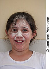 Girl Playing With Flour and Sieve - Girl playing with flour...