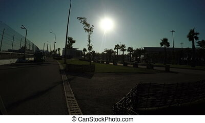Sochi in backlight sun - Directions to Autocar at Olympic...