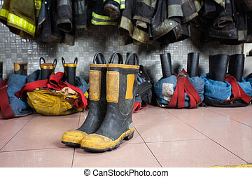 Boots On Floor At Fire Station - Firefighters boots on tiled...