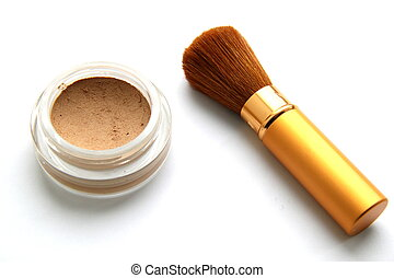 Brush and powder - Gold brush for a make-up and powder on a...
