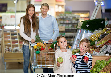 Family with children - Smiling family with cart