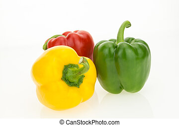 Yellow, green and red bell peppers, isolated on white background.
