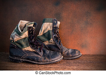 still life of old combat boots