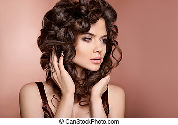 Hairstyle. Beautiful woman with makeup and healthy curly...