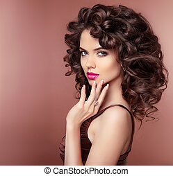 Makeup. Hair. Attractive brunette girl with healthy curly hairstyle and pink lips, manicured nails. Fashion Jewelry.
