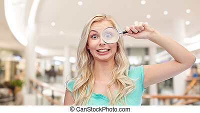 happy young woman with magnifying glass - vision,...