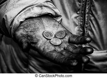 beggar - Dirty hands of a beggar with some coins