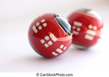 Antistress - Chinese metal red spheres on white background
