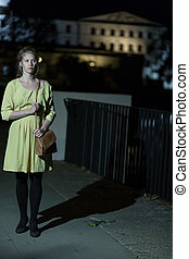 Lonely girl walking at night - Image of lonely girl walking...
