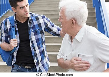 Young caring man offering help senior citizen