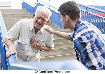 Strong chest pain - Elderly man suffering from strong pain...
