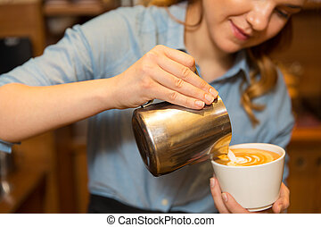 close up of woman making coffee at shop or cafe - equipment,...