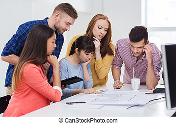 creative team with blueprint working at office - business,...