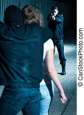 Holding girl hostage - Dangerous man is holding young girl...