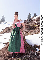 She is happy in sunshine in Dirndl - Elegant woman in dirndl...