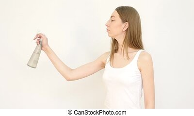 Pretty Girl with Pulverizer against White Background