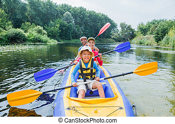 Family kayaking on the river - Active happy family. Boy with...