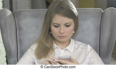 Portrait of Young Beautiful Blonde Woman Using Phone