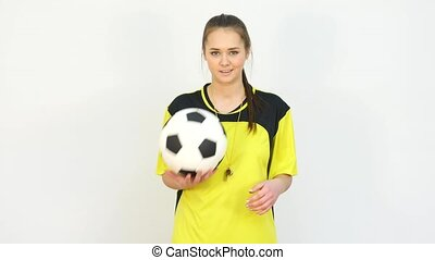 Referee Playing with Soccer Ball against White Background