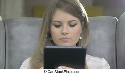 Portrait of Young Beautiful Smiling Woman Using Skype On...