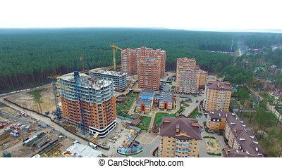 unfinished construction of multi-storey buildings. aerial...