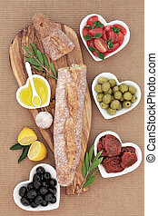 French Antipasti Feast - French baguette bread on an olive...