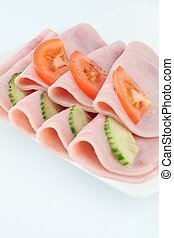 Ham and vegetables - Plate with slices of ham, tomatoes and...